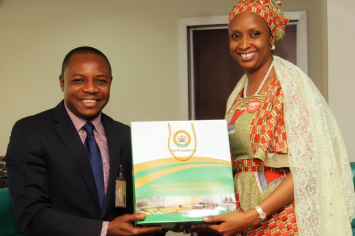 The Managing Director of the Nigerian Ports Authority (NPA), Hadiza Bala Usman (right); receiving a souvenir from the Leader of the Infrastructure Concession Regulatory Commission (ICRC), The Presidency, Director, Civil Service Transformation Department – Office of the Head of Service of the Federation, Gabriel .T. Aduda, when the Commission visited the Management of the NPA at the Organization's Corporate Headquarters in Marina, Lagos.