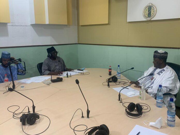 Executive Vice Chairman, Nigerian Communications Commission (NCC), Prof. Umar Danbatta (Right) and the two anchors, Yusuf Zain Dogara and Abba Bashir, in the studio during the radio programme on Radio Nigeria, Kaduna earlier today, Saturday, November 21, 2020.